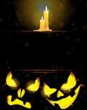 Jack o' Lanterns and burning candles Stock Photos