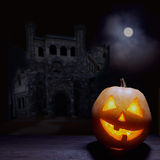 Jack o lanterns Halloween pumpkin face. On sinister castle and moon background Stock Image