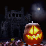 Jack o lanterns Halloween pumpkin face. On sinister castle and moon background Royalty Free Stock Photos