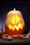Jack o lanterns  Halloween pumpkin face on wooden background Royalty Free Stock Photos