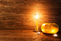Jack o lanterns Halloween pumpkin face on wooden background. Stock Images
