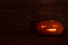 Jack o lanterns Halloween pumpkin on wooden background Royalty Free Stock Image
