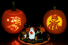 Jack O' Lanterns and Halloween Tabletop Display. Two carved and lit Jack O' Lanterns featuring Doby (the house elf from Harry Potter) and Linus (Peanuts Stock Photography