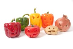 Jack-o-Lanterns made out of Fruit and vegetables. Halloween faces carved into vegetables such as potato, tomato, onion and capsicum instead of pumpkin forming Stock Photography