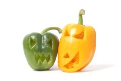Jack-o-Lanterns made out of vegetables. Halloween faces carved into yellow and green capsicum vegetables instead of pumpkin forming special jack o lanterns Stock Image