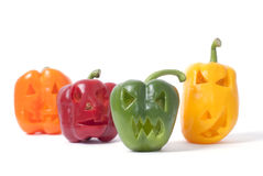 Jack-o-Lanterns made out of vegetables. Halloween faces carved into orange, red, yellow and green capsicum vegetables instead of pumpkin forming special jack o Royalty Free Stock Photo