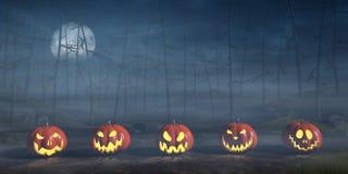 Jack O`Lanterns in a misty Halloween landscape at night Stock Image