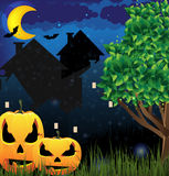 Jack o'Lanterns and night city Royalty Free Stock Image