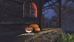 Jack-o-lanterns on the porch of gloomy house. Carved Halloween pumpkins on the porch of the gloomy house at night Stock Images