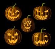 Jack o lanterns. Set of Jack O Lanterns, faces cut on pumpkin, detailed illustration, EPS 10, contains transparency Royalty Free Stock Images