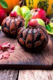 Jack-o-linterna en fondo de madera Concepto del otoño Víspera de Todos los Santos Fotografía de archivo libre de regalías