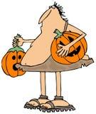 Jack-o-linternas que llevan del hombre de las cavernas Imagen de archivo libre de regalías