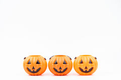 Jack o& x27;lantern pumpkinhead plastic on white background used for Royalty Free Stock Images