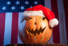 Jack-o '- lantern in a red Santa hat Royalty Free Stock Photos