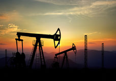 Jack pump and oil field Royalty Free Stock Images