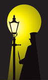 Jack The Ripper Through The Keyhole. A silhouette of jack the ripper with a knife in the light of a street lamp through a keyhole Stock Photo