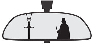 Jack The Ripper In Rear View Mirror. Jack the Ripper in a car rear view mirror isolated on a white background Royalty Free Stock Images