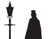 Jack The Ripper and Street Light. A silhouette of Jack the ripper next to a traditional old street light isolated on a white background Royalty Free Stock Photo