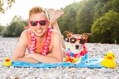 Dog and owner at the beach Royalty Free Stock Images
