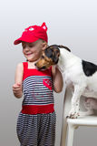 Jack Russell Terrier licking little girl Royalty Free Stock Images