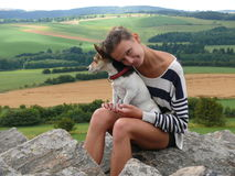 Jack Russell Terrier sitting on lap of girl Stock Photo