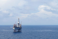 Jack up drilling rig in the middle of the ocean Royalty Free Stock Photography