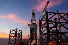 Jack Up Drilling Rig at Twilight Time Stock Images