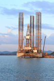 Jack up oil drilling rig in the shipyard Royalty Free Stock Photo