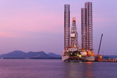 Jack up oil drilling rig in the shipyard Stock Photos