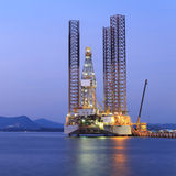 Jack up oil drilling rig in the shipyard for maintenance Royalty Free Stock Photography