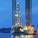 Jack up oil drilling rig in the shipyard for maintenance Royalty Free Stock Images