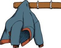 Jacke gehangen oben an Zahnstange Lizenzfreies Stockfoto