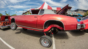 Jacked up Ride. A red hot rod on display at the California State Fair in Sacramento, California Royalty Free Stock Photo