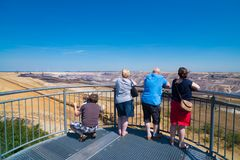 Touristic viewpoint at an opencast mine in Germany. JACKERATH, GERMANY - JULY 7, 2018: Skywalk with unknown people at the Garzweiler open pit brown coal mine stock photos