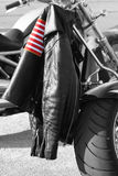 Jacket. Photo shot of a leather jacket draped on the back of a motorcycle Royalty Free Stock Photo