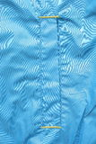 Jacket. Blue polyester fabric jacket pocket Stock Image