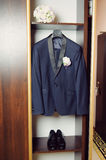 Jacket and Bouquet in Wardrobe. Jacket, shoes and wedding bouquet in wardrobe Royalty Free Stock Photography