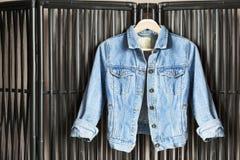 Jacket on clothes rack Stock Photos