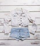 Jacket and light blue shorts. Stock Images