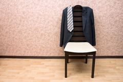 Jacket on the modern chair Stock Photos
