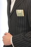 Jacket from  pocket dollars Royalty Free Stock Images