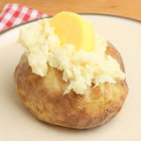 Jacket Potato with Butter Stock Photography