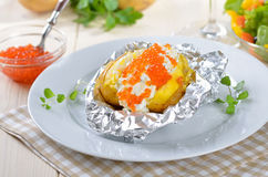 Jacket potato with caviar Royalty Free Stock Photo