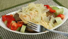 Jacket potato with cheese and onion Stock Image
