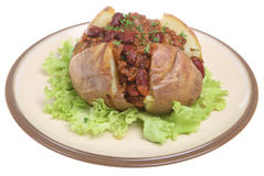 Jacket Potato with Chilli. Baked potato stuffed with chilli con carne Royalty Free Stock Images