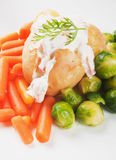 Jacket potato with cream sauce Stock Image