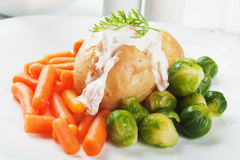 Jacket potato with cream sauce Royalty Free Stock Photo