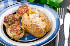 Jacket potato with meatballs Stock Images