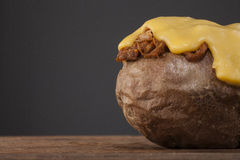 Jacket of potato with pulled pork and melting cheese on top Royalty Free Stock Image