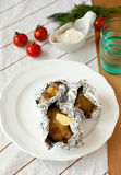 Jacket potatoes. On a plate Stock Images